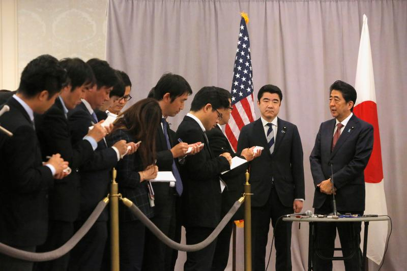 Japanese Prime Minister Shinzo Abe addresses members of the media after meeting with Donald Trump, New York, November 2016.