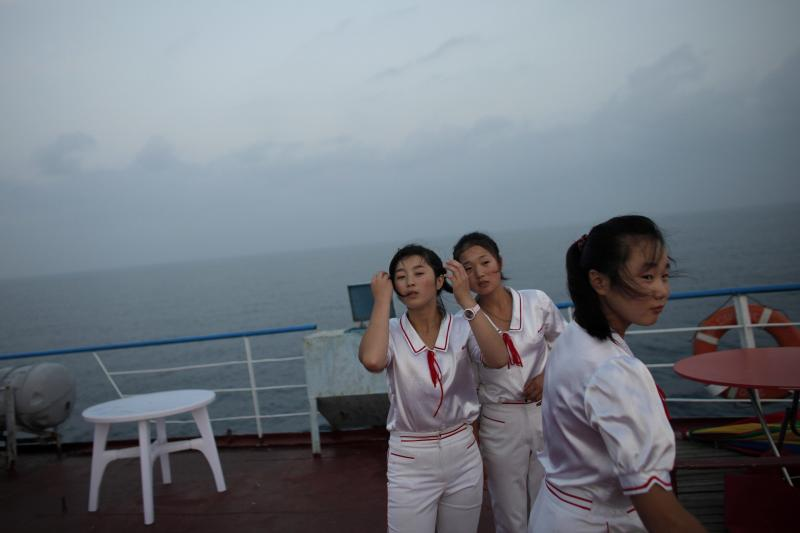 Workers stand on the deck of the Mangyongbyong cruise ship, operated by the North Korean state tourism agency, September 2011.