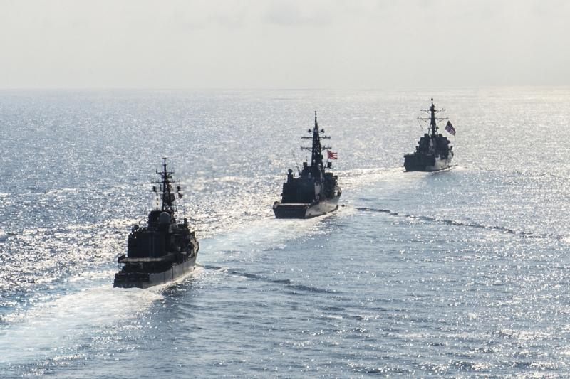 The Arleigh Burke-class guided-missile destroyer USS Mustin transits in formation with Japan Maritime Self-Defense Force ships in the South China Sea, September 2016.