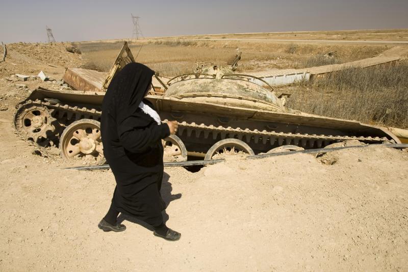An Iranian woman walks by an abandoned Iraqi tank in Khoozestan province, March 2007.