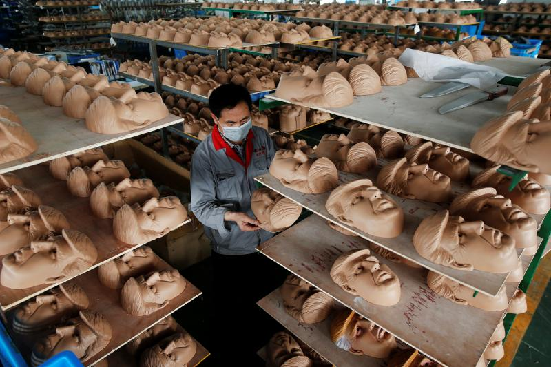 A worker inspects a mask of then-presidential candidate Donald Trump in Jinhua, China, May 2016.