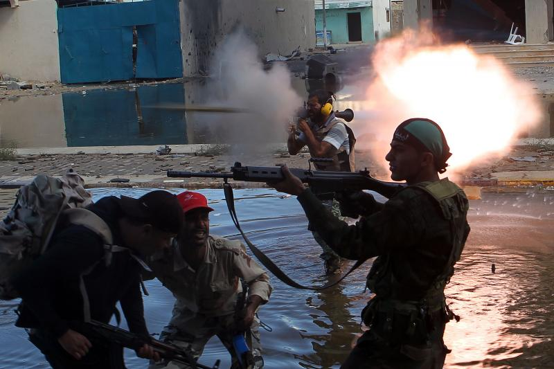 Anti-Gaddafi rebels fight government forces in Sirte, Libya, October 2011.