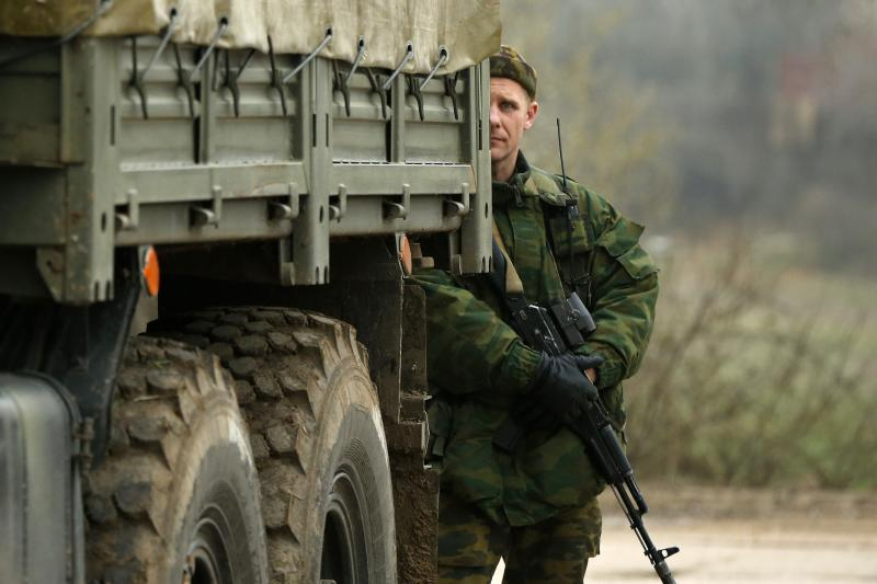 A uniformed man, believed to be a Russian serviceman, outside Sevastopol, March 2014