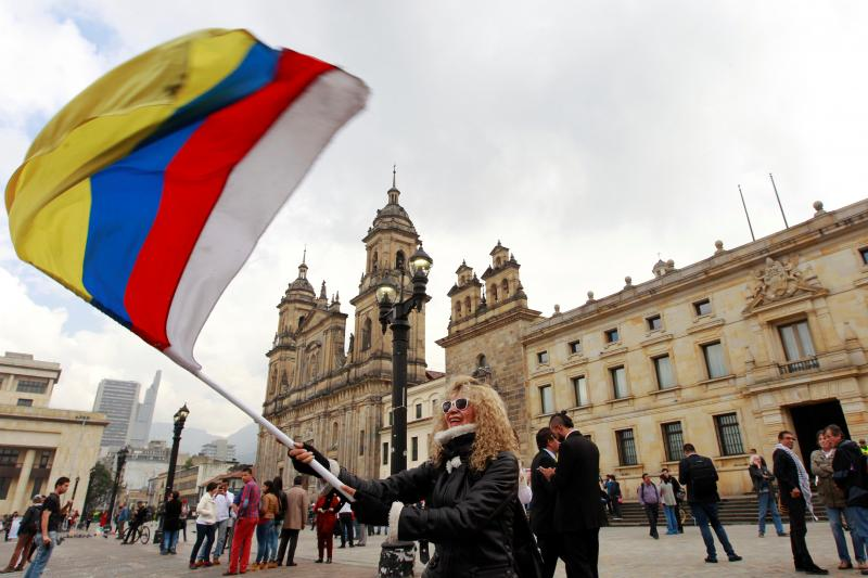 People demonstrate on the street as the FARC peace accord is signed in Bogota, Colombia, November 2016.