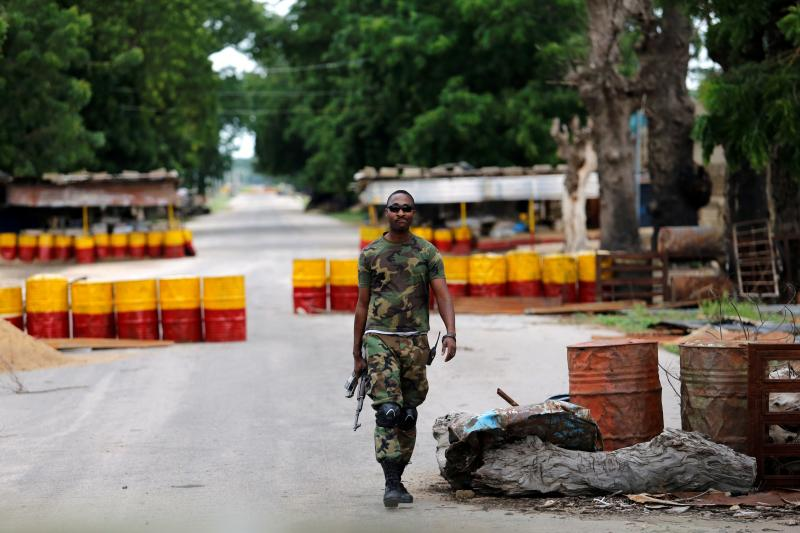 A soldier walks past a checkpoint in Bama, Borno State, Nigeria, August 2016.