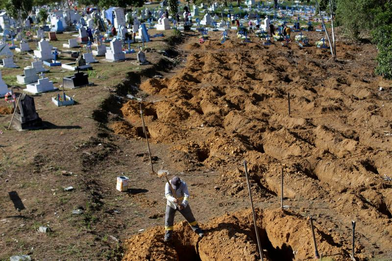 A worker prepares graves for inmates who died during a prison riot, at the cemetery of Taruma in Manaus, Brazil, January 2017.