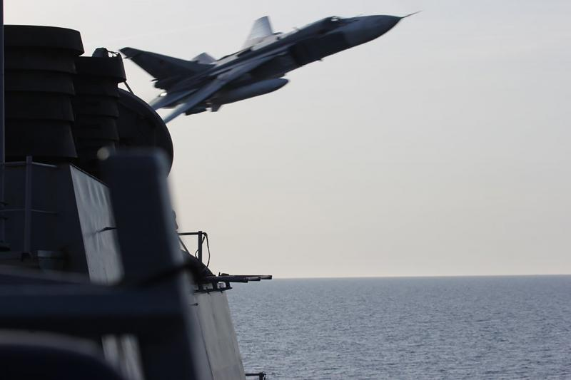 A Russian attack aircraft making a low pass close to the U.S. guided missile destroyer USS Donald Cook in the Baltic Sea, April, 2016.