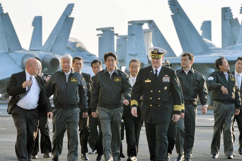 Japanese Prime Minister Shinzo Abe on board the USS Ronald Reagan near Tokyo, October 2015.