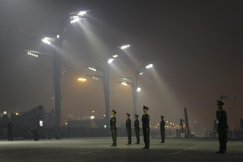 Paramilitary police officers standing guard in Beijing, October 2014.