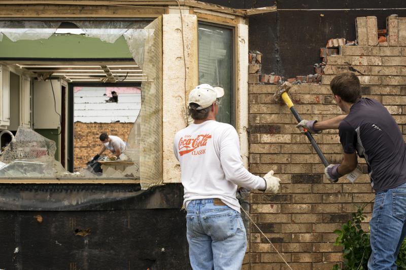 Volunteers help demolish a damaged house in Moore, Oklahoma, May 2013.
