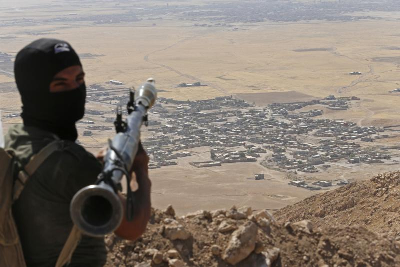 A peshmerga fighter above the ISIS-controlled Baretle village near Mosul, Iraq, September 2014.