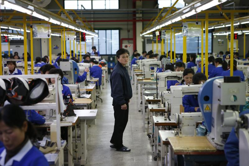 North Korean workers in the Joint Industrial Park in the Kaesong industrial zone, December 2013.