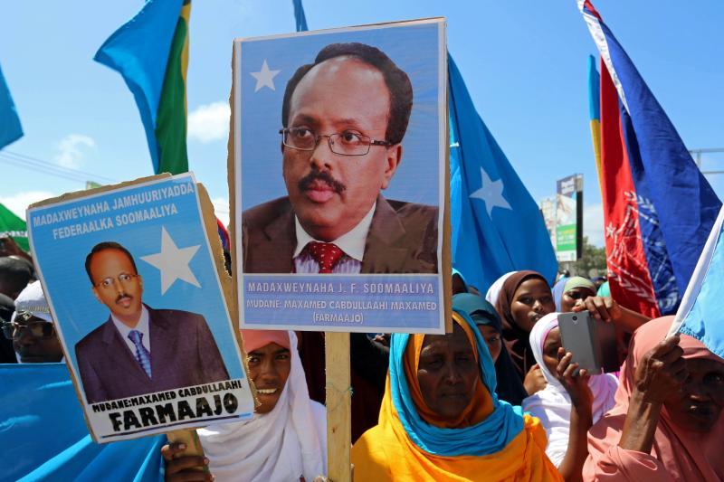 Women carry posters with the image of the newly elected Somali president, Mohamed Abdullahi Mohamed in Mogadishu, Somalia, February 2017.