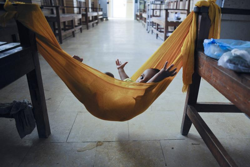 The child of a midwife lies in a hammock inside a Karachi maternity ward, October 2011.