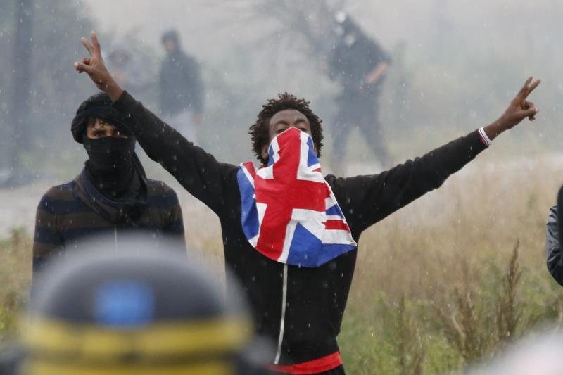 """A migrant at a protest in the """"jungle"""" refugee camp in Calais, France, October 2016."""