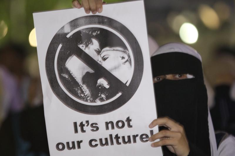 A Muslim student protests a concert by the gay singer Adam Lambert in Malaysia, October 2010.