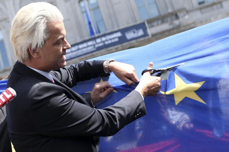 Wilders cuts a star from the European Union flag during a demonstration in front of the EU Parliament in Brussels, May 2014.