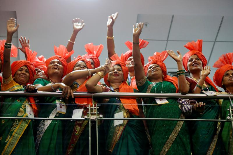 """""""Sarpanch"""" women (village heads) wave towards the Indian Prime Minister Narendra Modi as he arrives for an event to honor them for their efforts towards the Clean India campaign, to mark the International Women's Day in Gandhinagar, India, March 8, 2017."""