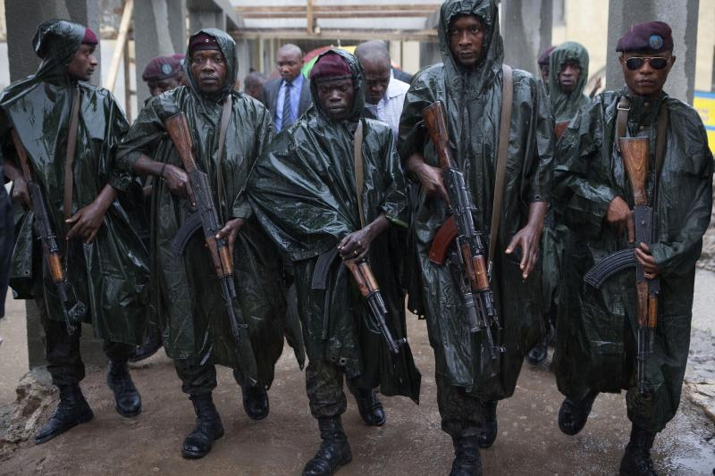 Members of Congo's presidential guard walk ahead of President Joseph Kabila (not pictured) as he leaves a polling station in Kinshasa, November 2011.