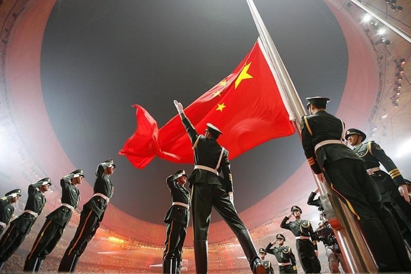 China's national flag is raised during the opening ceremony of the Beijing 2008 Olympic Games at the Bird's Nest Stadium, August 2008.