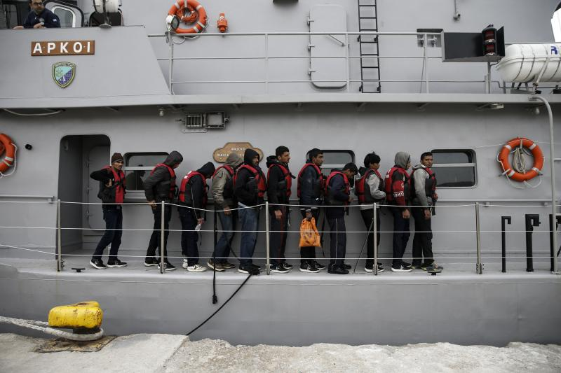 Refugees on a Greek Coast Guard vessel docking on the island of Lesbos, March 2016.