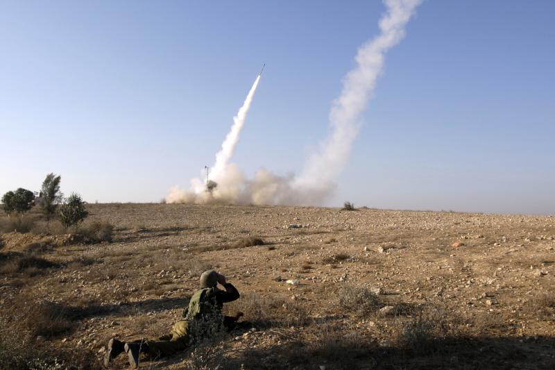 An Israeli soldier watching an Iron Dome launcher firing an interceptor rocket near Beersheba, Israel, November 2012.