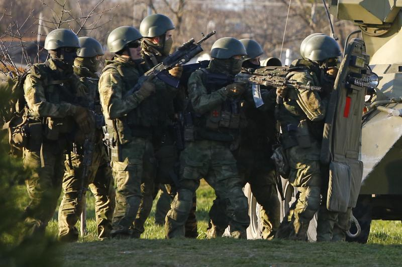 Armed men, believed to be Russian servicemen, during the invasion of Crimea, near Belbek, March 22, 2014.