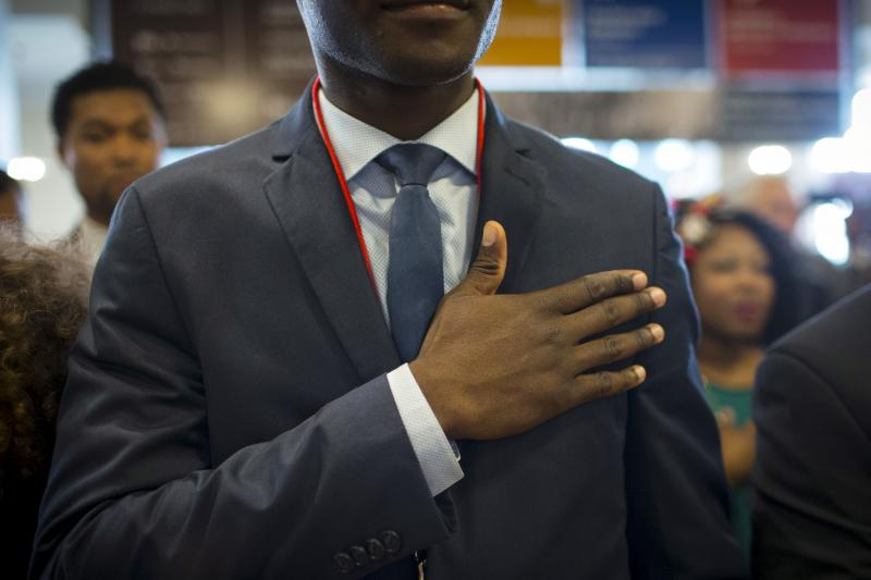 A new U.S. citizen during a naturalization ceremony at Ellis Island, May 2015.