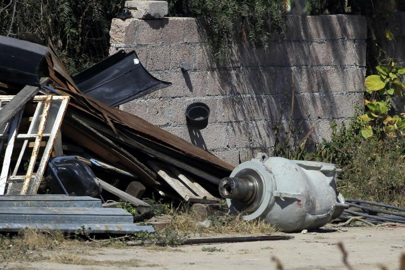 A container reportedly used to transport cobalt-60 (R) that was being sent from a hospital to a radioactive waste-storage center, is seen at a home near where the dangerous radioactive medical material was found in a truck in the town of Hueypoxtla, near