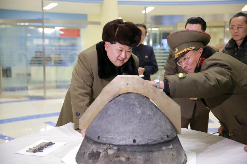 North Korean leader Kim Jong Un looking at a rocket component in Pyongyang, March 2016.