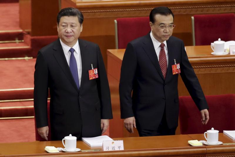 Chinese President Xi Jinping and Premier Li Keqiang arrive for the opening session of the National People's Congress in Beijing, March 2016.