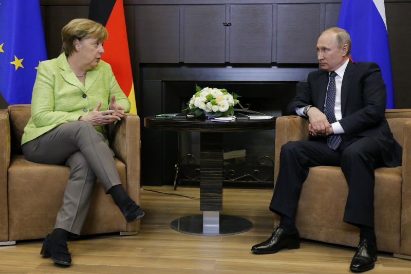 German Chancellor Angela Merkel talks to Russian President Vladimir Putin during their meeting at the Bocharov Ruchei state residence in Sochi, Russia, May 2017.