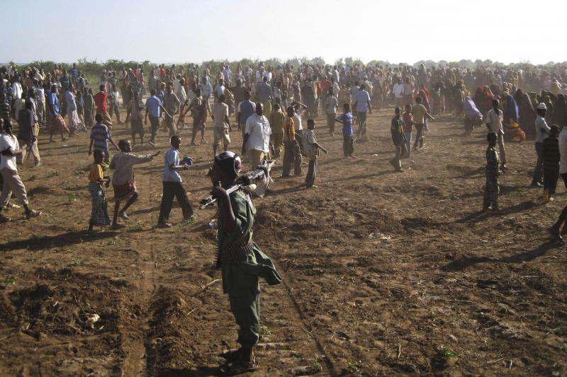 An al-Shabab fighter stands at a public execution site where a man was executed by the group in Bula Marer town, Somalia, December 2008.