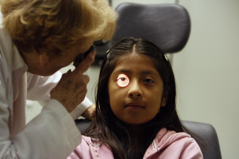 An uninsured patient has her eyes tested at a clinic in Venice, California, June 2009