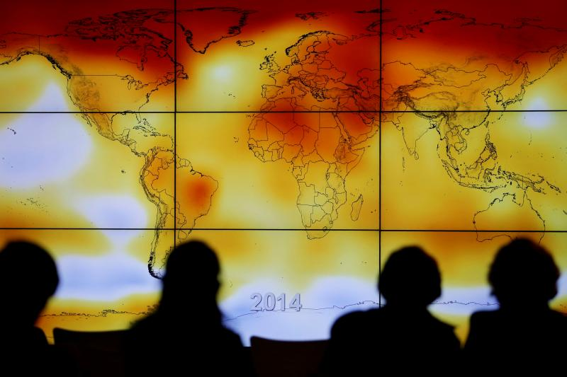 A screen shows world temperature anomalies at the 2015 World Climate Change Conference at Le Bourget, France, December 2015