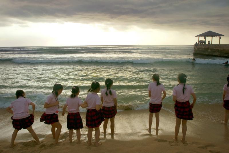 Chinese children play on a beach in Honolulu, Hawaii, February 2007.