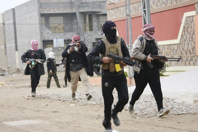 Tribal militiamen patrol the streets of Fallujah, January 2014.
