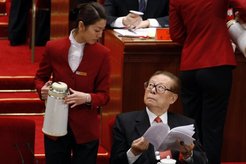Former Chinese President Jiang Zemin looking at a steward during the opening ceremony of the 17th Party Congress in Beijing, October 2007.
