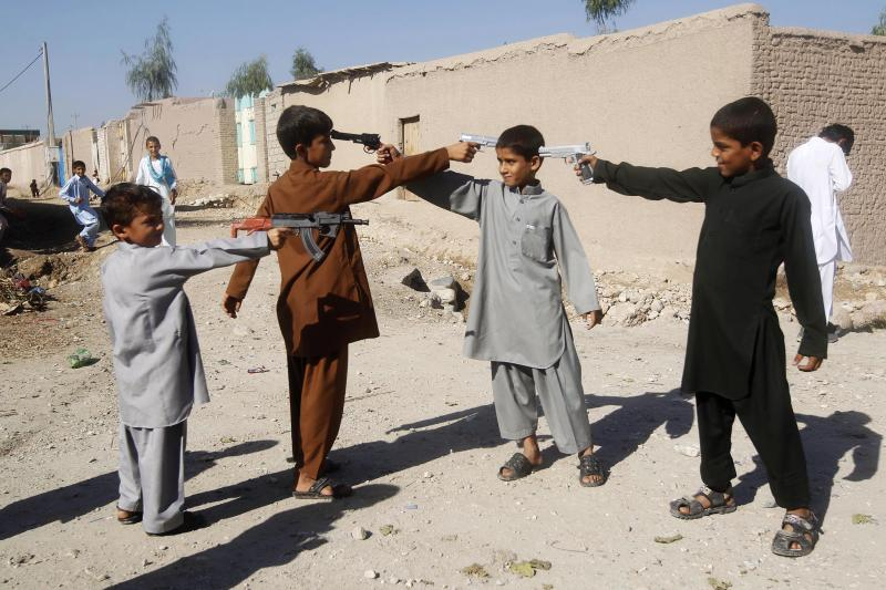 Afghan boys play with toy guns on the first day of Eid al-Adha in Jalalabad, October 2015.