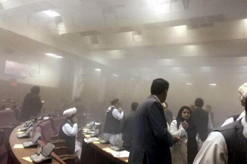 Afghan members of parliament are evacuated after an attack by the Taliban, June 2015.