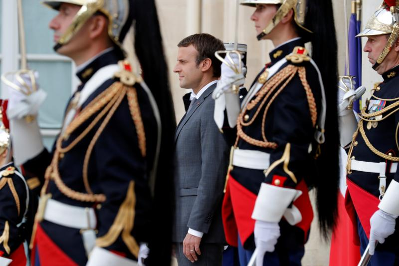 Macron waits for guests to leave the Élysée Palace in Paris, July 2017.
