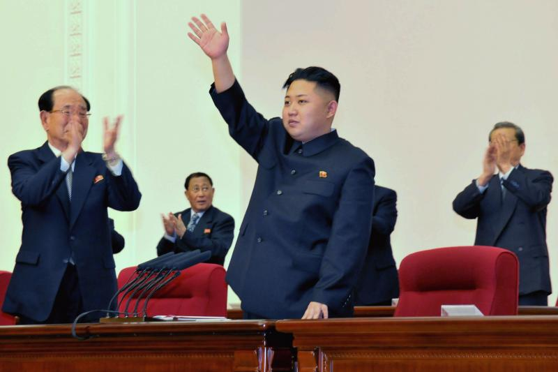 North Korean Supreme Leader Kim Jong Un waves during a WPK party conference in Pyongyang, April 2012.