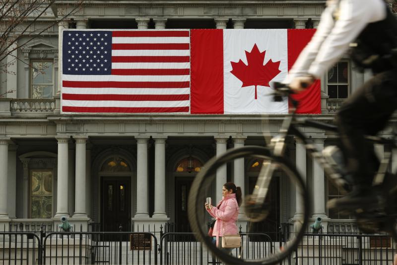 Canadian and American flags on display during Trudeau's visit to Washington, D.C., March 2016