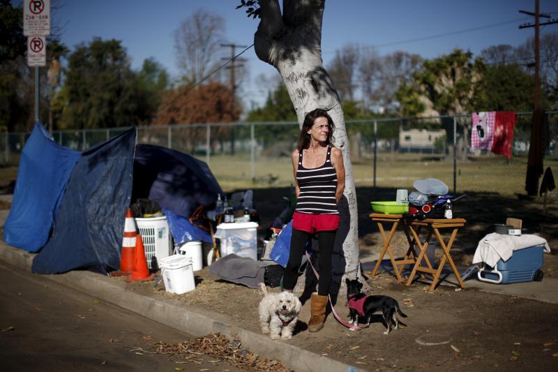 A homeless veteran outside a tent encampment near Los Angeles, California, December 2015.