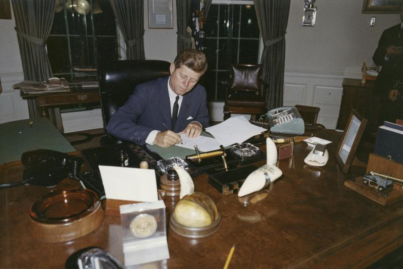 President John F. Kennedy signs a proclamation for the interdiction of the delivery of offensive weapons to Cuba during the Cuban missile crisis, October 1962.