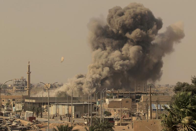 Smoke rises after an air strike during fighting between members of the Syrian Democratic Forces and ISIS militants in Raqqa, Syria, August 2017
