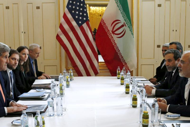 John Kerry meets with Iranian Foreign Minister Mohammad Javad Zarif on the day the International Atomic Energy Agency verified that Iran had met all conditions under the nuclear deal, Vienna, January 2016