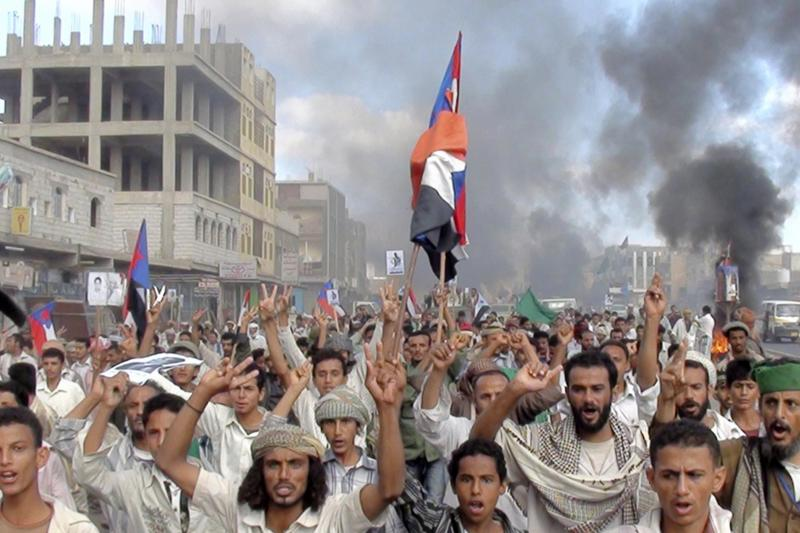 Protesters march during an anti-government demonstration in Radfan, a district in the southern Yemeni province of Lahej, January 2011