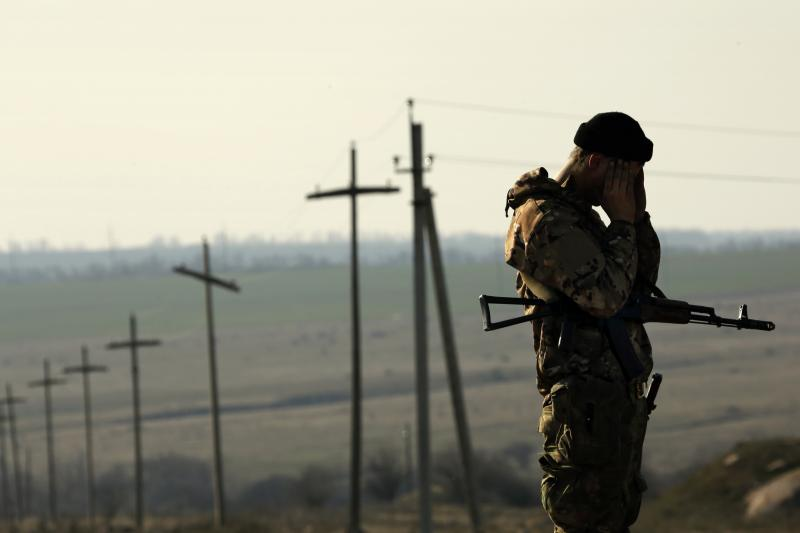 A Ukranian soldier outside a military camp near the Russian border, March 2014