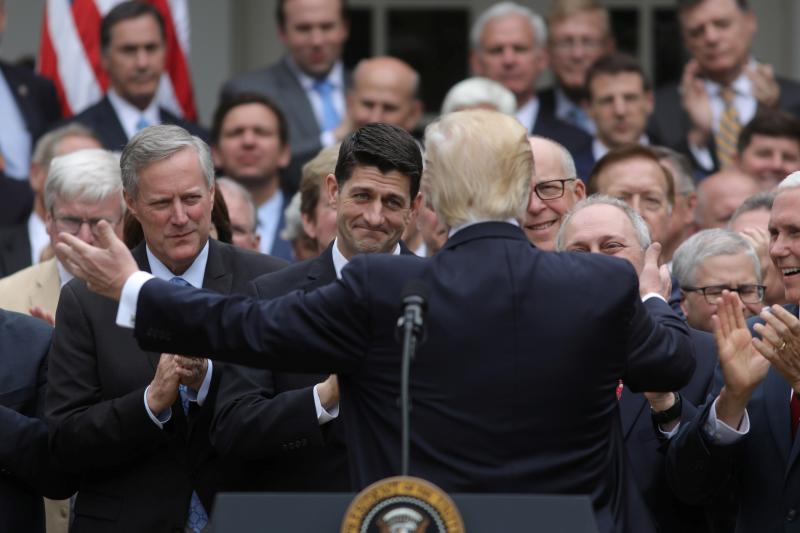 Trump, Ryan, and House Republicans celebrate in the Rose Garden after the House passed its Obamacare repeal bill, May 2017.